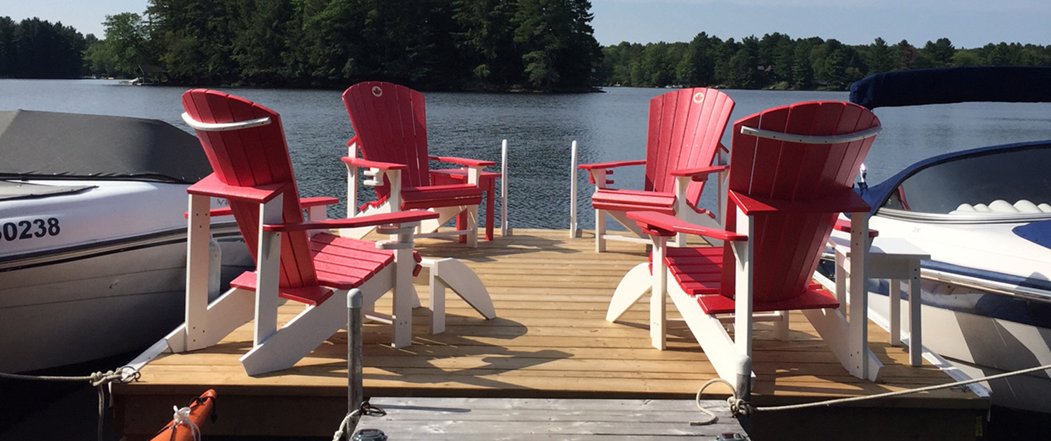 Red Muskoka Chairs at Butterfly Lake Resort